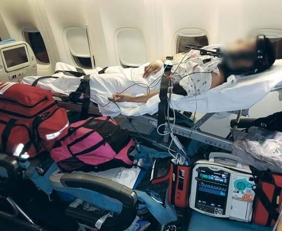A patient on a commercial stretcher Flight